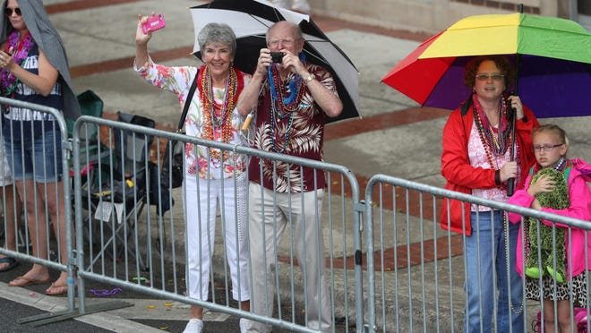 Spectators ride out the rain during Springtime Tallahassee's Parade last Saturday.