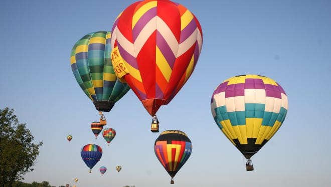 Hot air balloons fill the sky during the National Balloon Classic in Indianola.