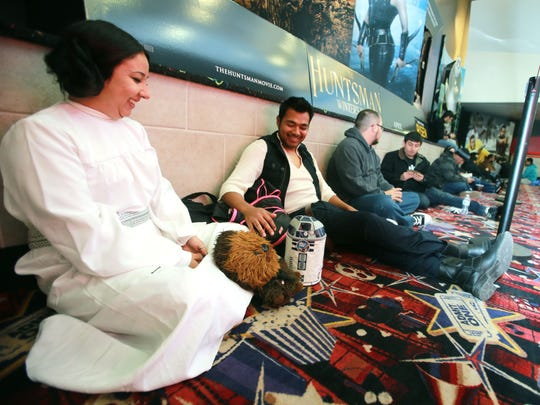 Sandra Hardy dressed as Princess Leah and Jonathan Lucero dressed as Hans Solo as they waited for the first showing of the new Star Wars movie Thursday at the Bassett Place Premier Cinemas.