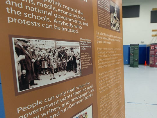 Pictured is a panel from a Holocaust display called