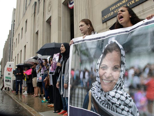 A rally for Rasmieh Odeh takes place outside of the Theodore Levin courthouse in Detroit on Thursday Aug. 17, 2017.