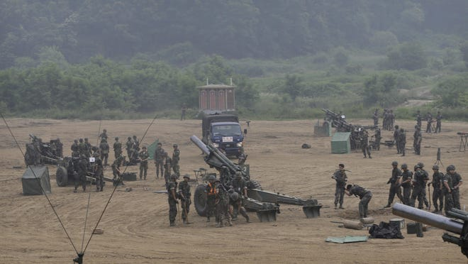 South Korean army soldiers prepare to fire 105mm howitzers during an exercise in Paju, South Korea, near the border with North Korea Wednesday, June 22, 2016. In a remarkable show of persistence, North Korea on Wednesday fired two suspected powerful new Musudan mid-range missiles, U.S. and South Korean military officials said, but at least one of the launches apparently failed, Pyongyang's fifth such reported flop since April.