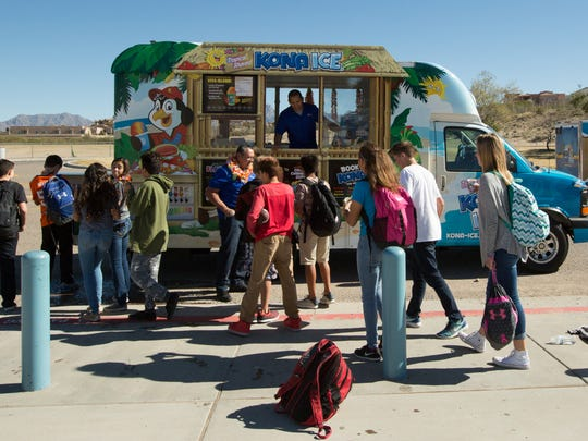 Keith Placencio, owner of Kona Ice, and his son Guillermo Placencia sell shaved ice to the students at Camino Real Middle School Tuesday November 22, 2016.