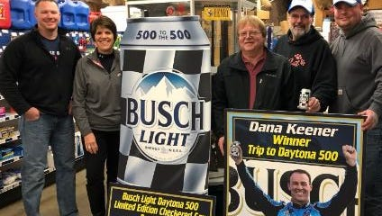 Dana Keener, second from right, won a trip to the Daytona 500 from a pack of Busch Light purchased at Glenn's Market. He will take his nephew, Jeremy Searfos, right. Also pictured Micheal Hinger, left, and Kelly Dyer, of Matesich Distributing; and Greg Myers, middle, from Glenn's Market.