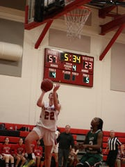 Taylor Rondandini made this layup with 5:32 to play Monday to give her 23 for the game and 1,000 for her career.