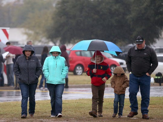 Families brave the cold, rainy weather to attend Christmas
