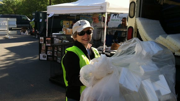 A GreenWorks volunteer handles a mound of Styrofoam at a previous Hard 2 Recycle Day.
