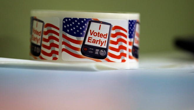 """""""I Voted Early"""" stickers are seen at an early voting polling site, in Texas, Feb. 2014."""