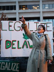Delaware NORML executive director Cynthia Ferguson points up to lawmakers in the Louis L. Redding City/County building before leading a march through Wilmington in 2014 in support of marijuana decriminalization and legalization.