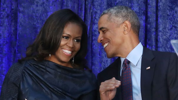 Former president Barack Obama and first lady...