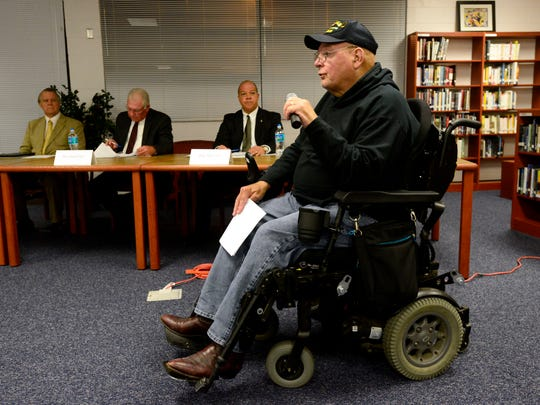 Veteran Ray Goodwin speaks about proposed changes to a statute regarding the Pledge of Allegiance in the classroom Tuesday at Pace High School during a Santa Rosa County Delegation meeting.