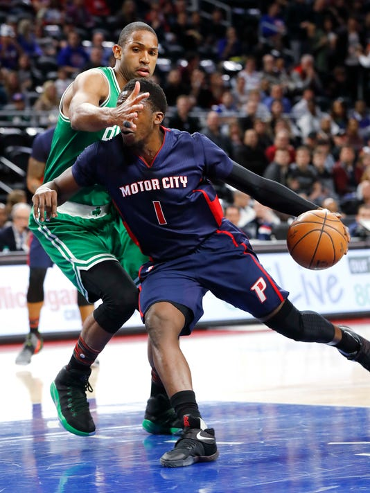 Boston Celtics center Al Horford (42) defends Detroit Pistons guard Reggie Jackson (1) in the first half of an NBA basketball game in Auburn Hills, Mich., Sunday, Feb. 26, 2017. (AP Photo/Paul Sancya)
