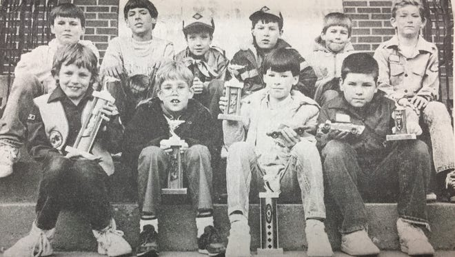 The Pack 44 Scouts of Uniontown held their Second Annual Pinewood Derby in March 1988. The winner was Jerrod Owen. Pictured from left in the front row are the participants in the contest, Owen, second place winner Travis Johnson, third place winner Joey Brewer, and Jay Butler, who won best looking car. Back row, Ray Graham, Jason Clark, Alan Dayberry, Andy Brewer, Brad Gough and Brad Conley.