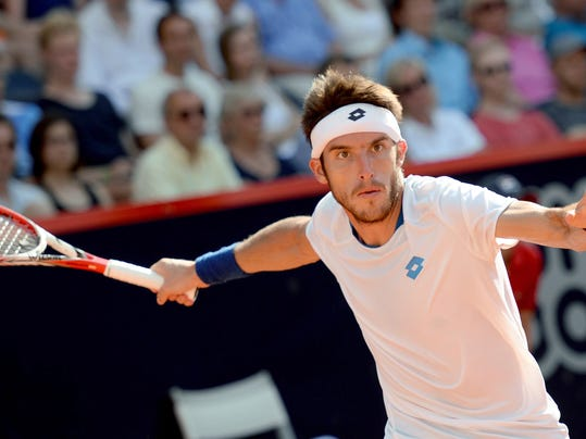 Leonardo Mayer of Argentina returns a shot to Germany's Philipp Kohlschreiber in their semi final match at the German Open tennis tournament in Hamburg, Germany, Saturday, July 19, 2014. Mayer won the match with 7-5 and 6-4. (AP Photo/dpa, Daniel Reinhardt)