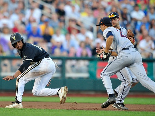 Vanderbilt's John Norwood, left, is tagged out by Virginia's Daniel Pinero in a run-down in the fourth inning Tuesday.
