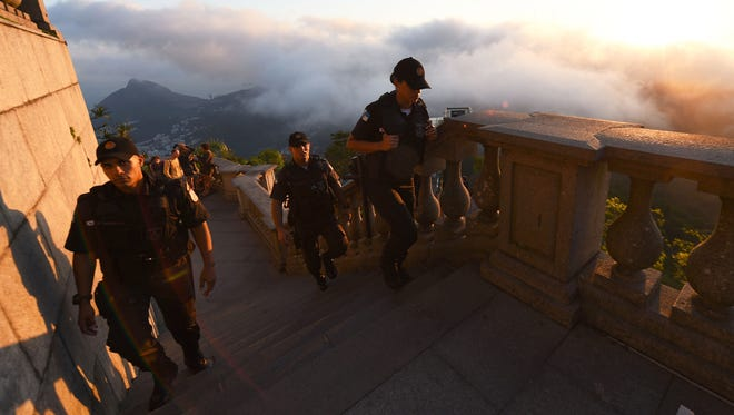 Brazilian military police patrol near the Christ the Redeemer statue prior to the Rio 2106 Olympic Games.