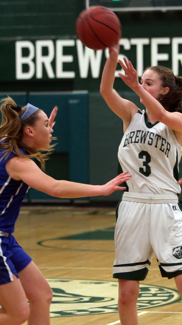Brewster's Maggie DePaoli (3) passes over  Pearl River's
