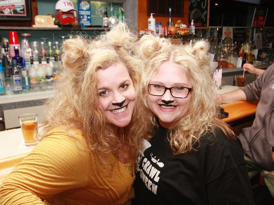 Lions, Amber Suedmeyer and Melissa Smith enjoy a drink at Lakeview Lounge with the BCMAMS for Crawl-o-Ween Saturday night.