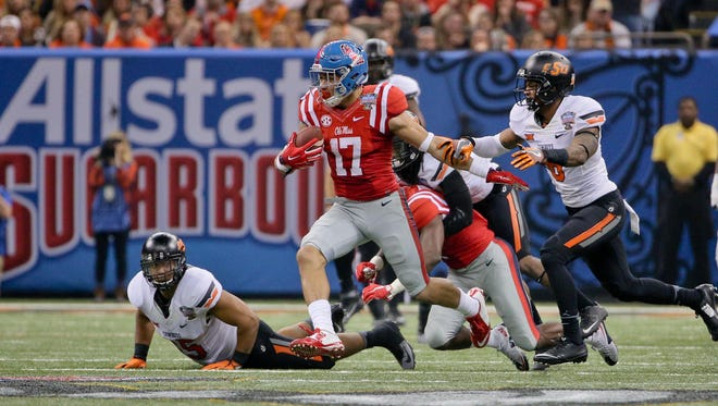 Tight end Evan Engram (17) runs after a catch against the Oklahoma State Cowboys during the second quarter in the 2016 Sugar Bowl at the Mercedes-Benz Superdome.