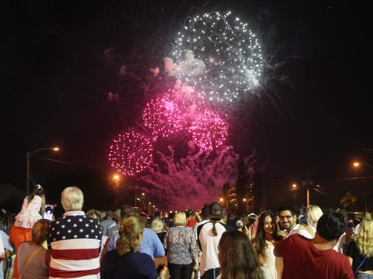 Visitors to downtown Cape Coral watch fireworks while