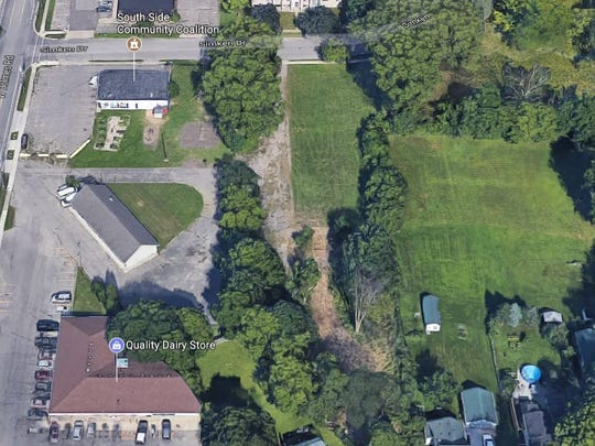 This grassy area near West Holmes and Pleasant Grove roads is the proposed site for the Beacon Southwest Soccer Field. Organizers want to build the field behind the South Side Community Coalition, 2101 W. Holmes.