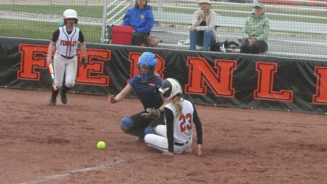 Fernley's Alexandria Conder slides safely into home plate during a game against South Tahoe on April 11.