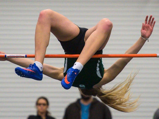 St. Johnbury Academy's Katherine Cowan makes her winning high jump during the high school indoor track and field state championships in Northfield on Saturday, February 4, 2017.