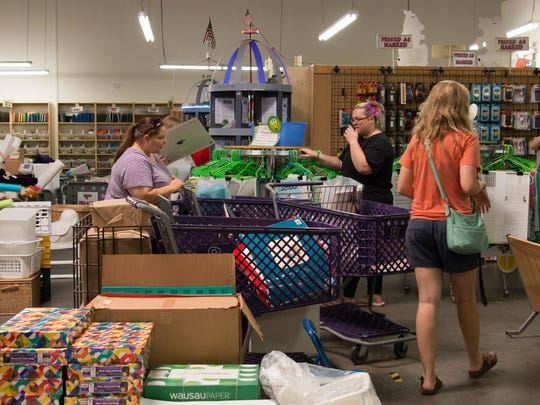 Teachers shop for supplies at Treasures 4 Teachers on July 25, 2018.