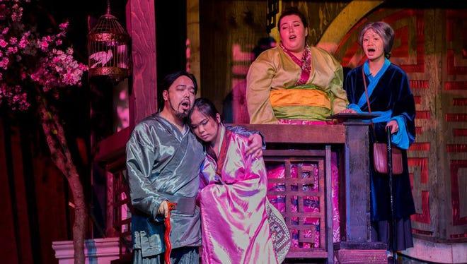 Ernest Ochoco as Mulan's father, Fah Zhou, with Kai Barrer (Mulan), Anna Prelosky (Fa Li) and Kristelle Cefre (Grandmother Fa)