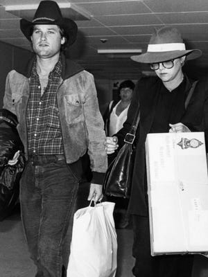 """Actor Kurt Russell, who plays legendary rock and roll singer Elvis Presley in the film """"Elvis' arrives at London's Heathrow Airport accompanied by his former wife, actress Season Hubley, in May 1979."""