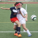 Livonia Franklin senior Sara Cable advances the ball during a match earlier this month against Churchill.