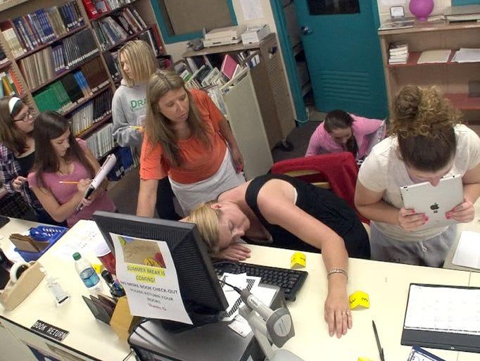 Lake Riviera Middle School teacher Brenda Coyle helps ...