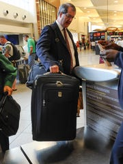 FILE - Delta is offering 2,500 bonus miles to existing members of its frequent flier program if checked baggage isn't on the carousel within 20 minutes of the plane arriving at the gate. (AP Photo/John Amis, File)