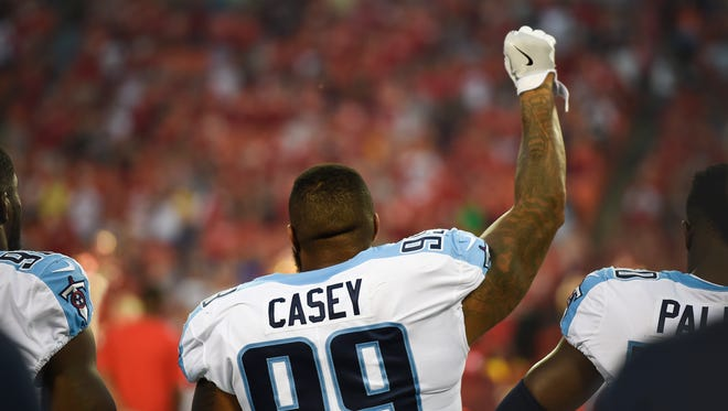 Tennessee Titans defensive end Jurrell Casey (99) raises his fist at the end of the National Anthem before the start of their preseason game against the Kansas City Chiefs at Arrowhead Stadium Thursday, Aug. 31, 2017 in Kansas City, Mo.