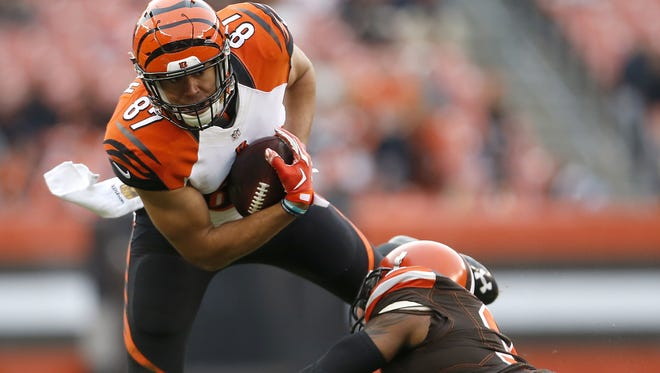 Cincinnati Bengals tight end C.J. Uzomah (87) leans forward after making his first career catch in the fourth quarter during the Week 13 NFL game between the Cincinnati Bengals and the Cleveland Browns, Sunday, Dec. 6, 2015, at FirstEnergy Stadium in Cleveland. The Bengals won 37-3.