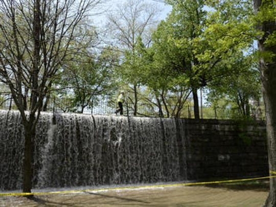 Water cascades off the Tyler Park Bridge after a water main break in 2014.  Water floods Tyler Park and surrounding area due to a water main break. Water cascades into a water fall off Baxter Ave. into Tyler Park. April 24, 2014.  Photo by Arza Barnett, The Courier-Journal