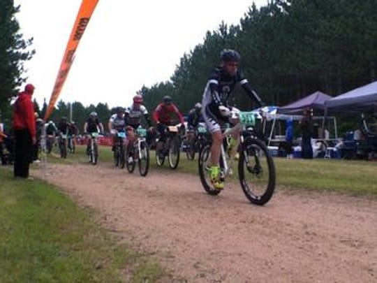 Bikers begin the Wausau 24 race at Nine Mile County Forest Recreation Area in Rib Mountain in 2013.