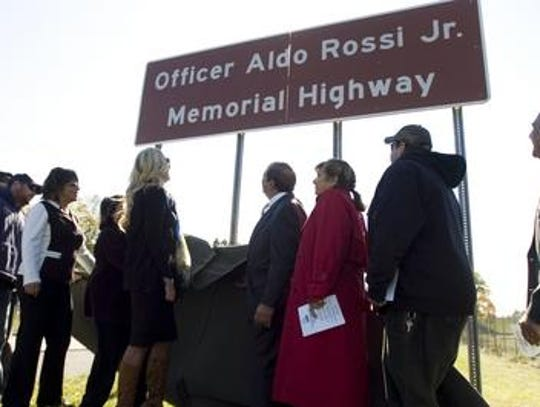 The Officer Aldo Rossi Jr. Memorial Highway sign is