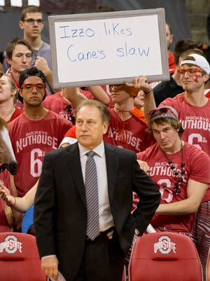 Members of Ohio State's student section taunt Michigan State coach Tom Izzo before Sunday's game  in Columbus. The Buckeyes won, 72-67.