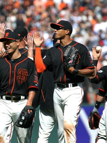 The Giants celebrate a 5-4 win over the Angels.