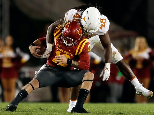 FILE - In this Sept. 28, 2017, file photo, Iowa State quarterback Jacob Park is sacked by Texas linebacker Malik Jefferson (46) during the second half of an NCAA college football game in Ames, Iowa. Don't expect a typical high-scoring Big 12 game when Texas plays Kansas State this week. While the Longhorns have struggled offensively, their defense is coming off an impressive performance in a 17-7 win at Iowa State, (AP Photo/Charlie Neibergall, File)