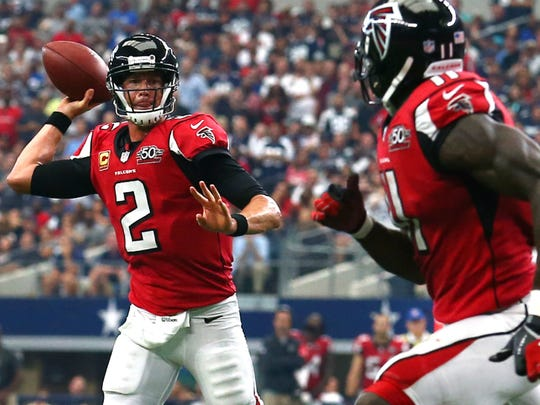 Quarterback Matt Ryan, No. 2, looks to pass to wide receiver Julio Jones in a game from the 2016 season.