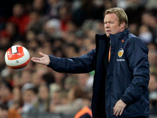 FILE - In this Sunday March 23, 2008 file photo, Valencia's coach Ronald Koeman, from the Netherlands, returns a ball during the match against Real Madrid at the Santiago Bernabeu stadium in Madrid. Southampton has hired former Dutch defender Ronald Koeman as its new manager. Koeman signed a three-year deal at the Premier League club on Monday June 16, 2014. (AP Photo/Victor R. Caivano, File)