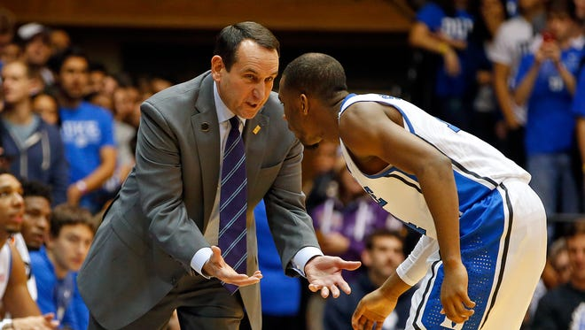 Duke head coach Mike Krzyzewski, left, speaks with Rasheed Sulaimon, right, during the first half of a game last week. Krzyzewski is 15 wins away from a 1,000 for his career.