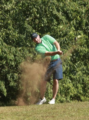 Josh Cameron blasts a shot on the 8th hole during the 94th Norwich Invitational on Sunday at the Norwich Golf Course. Cameron went on to defeat Todd Lavoie to win championship.