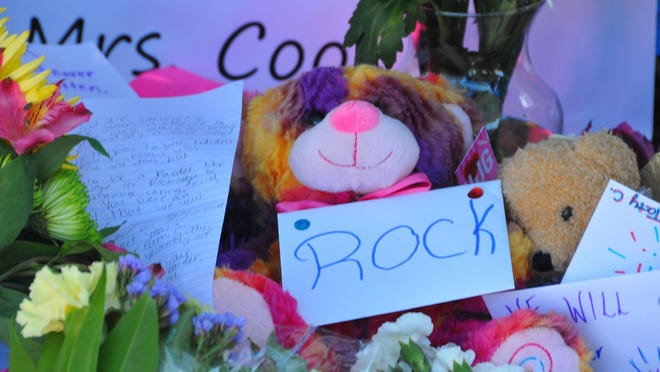 A memorial area recently blossomed at Rockledge High School for teacher Sandra Cook. Melbourne police said Cook's estranged husband killed her, then himself. Students added flowers, notes, artwork and balloons to the memorial.
