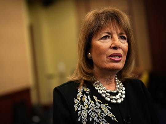 Rep. Jackie Speier (D-CA) speaks to a member of the media after a news conference Dec. 12, 2017 on Capitol Hill in Washington, D.C.