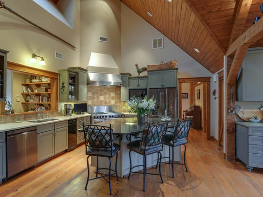 By focusing on this kitchen's unique roofline, master photographer Solomon Davis is able to showcase the room's large, open space. The photograph is an accurate representation of the space, while highlighting its assets.