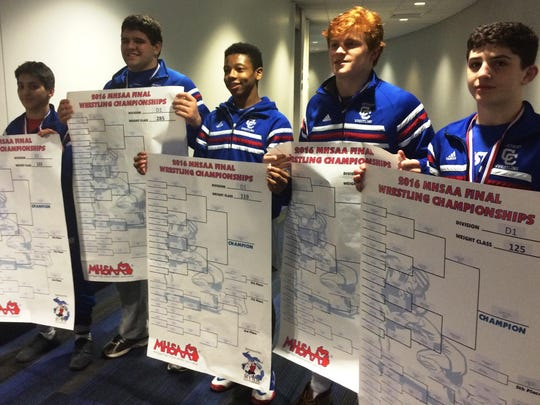 Catholic Central's five individual state wrestling champions included (from left) Ben Kamali, Nick Jenkins, Kevon Davenport, Tyler Morland and Cameron Amine.