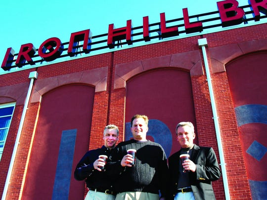 Iron Hill Brewery co-owners, Kevin Finn (left), Mark Edelson and Kevin Davies are unveiling a new beer in time for St. Patrick's Day. It's inspired by a visit to Ireland Finn and Edelson took before they opened the first brewery.